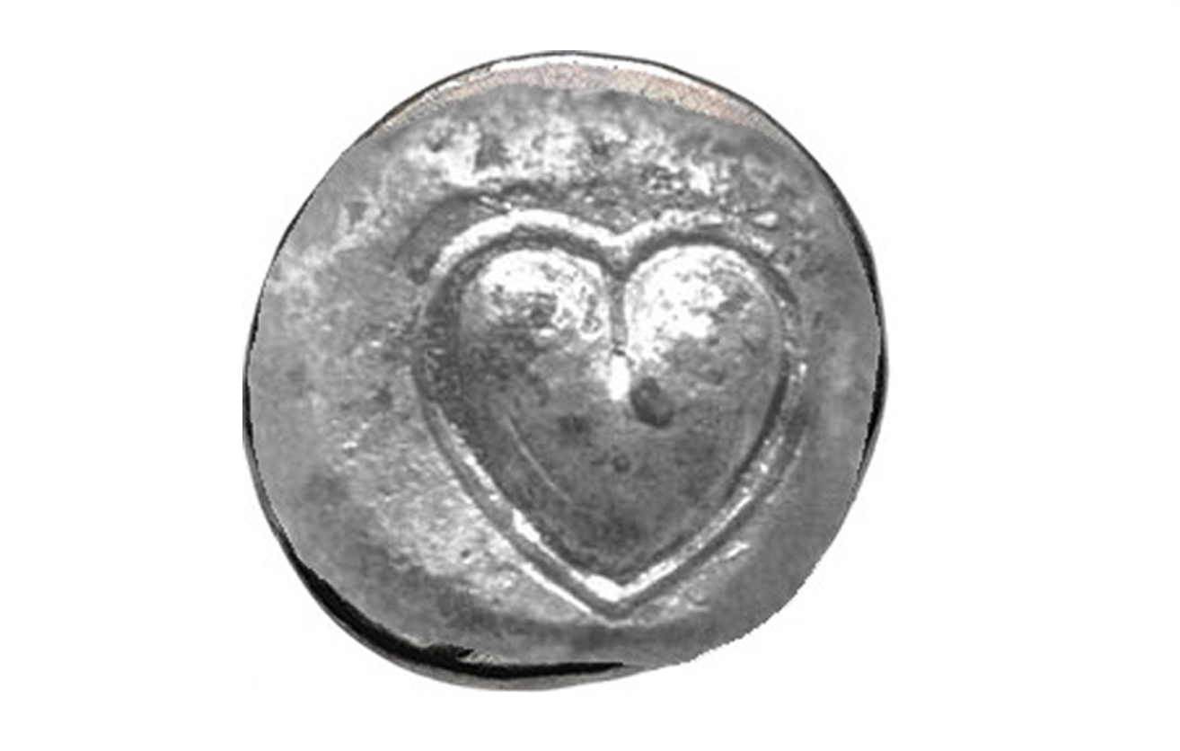 Ancient silver coin from Cyrene, Libya depicting the heart-shaped 'seed' (actually fruit) of Silphium.